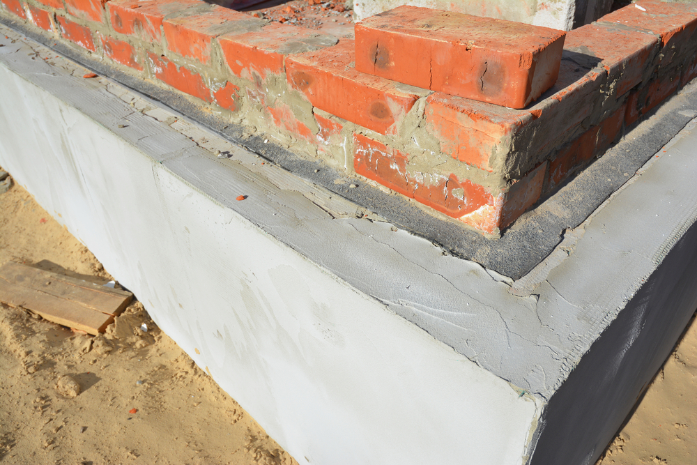 Damp proof membrane on top of foundation walls corner.