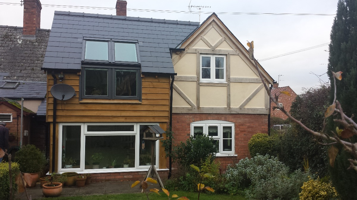 Half timbered first floor extension and modern side extension