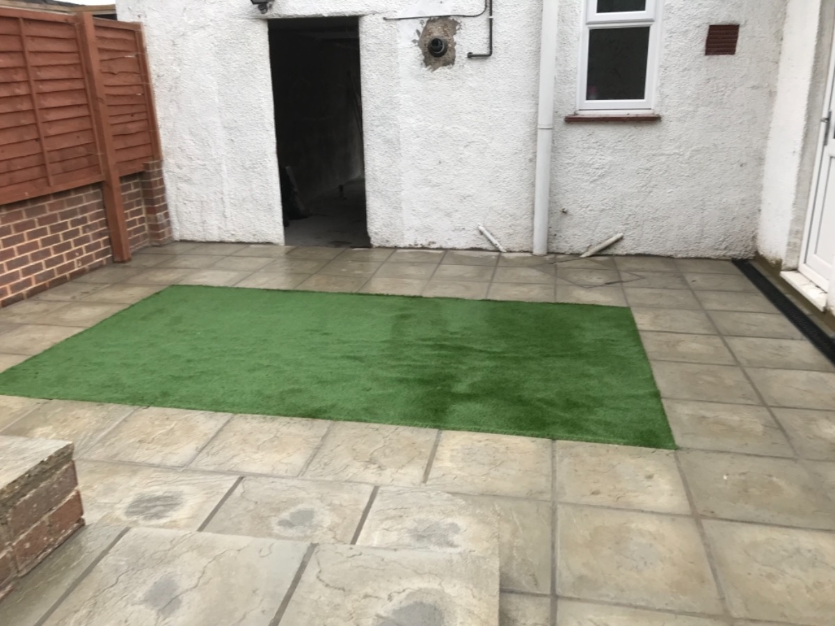 Patio slabs with artificial turf
