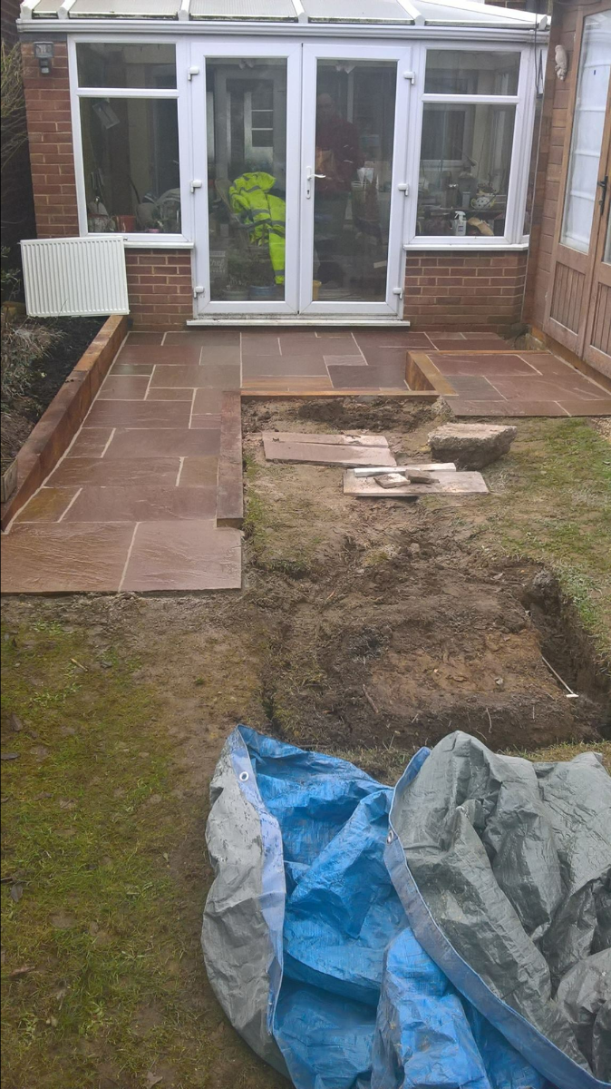 Sandstone patio with a ramp access