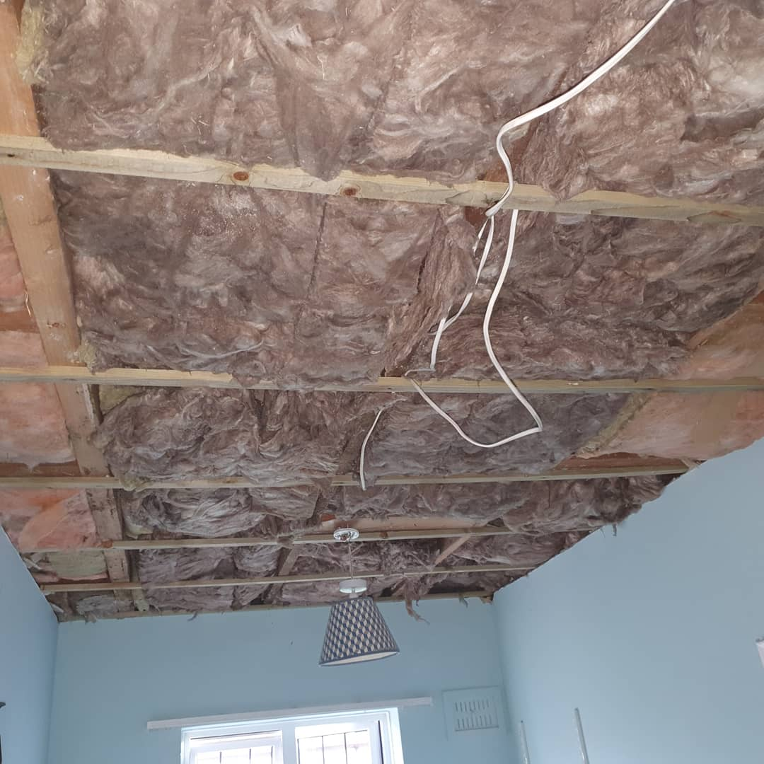 Insulation off water damaged ceiling